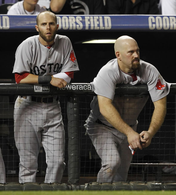 Red Sox second baseman Dustin Pedroia, left, and first baseman Kevin Youkilis look on as pinch-hitter Mike Lowell grounds out against the Colorado Rockies to end the ninth inning of the Rockies' 2-1 victory in an interleague baseball game in Denver on Tuesday, June 22, 2010.