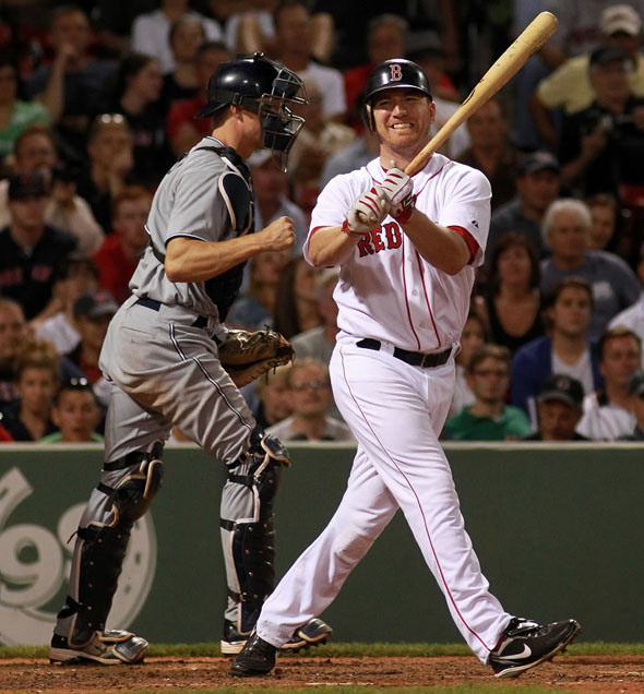 Boston Red Sox right fielder J.D. Drew (7) reacts as he swings and misses for the last out in the 9th ending the Sox's chances for a rally. The Boston Red Sox take on the San Diego Padres in Game 2 of Inter-League Play at Fenway Park