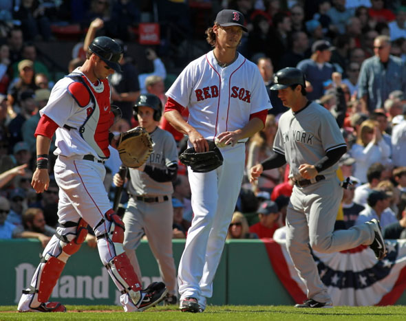 Boston Red Sox starting pitcher Clay Buchholz heads back to the mound after giving up a 3 run homer in the 4th. Boston Red Sox take on the New York Yankees at Fenway Park.