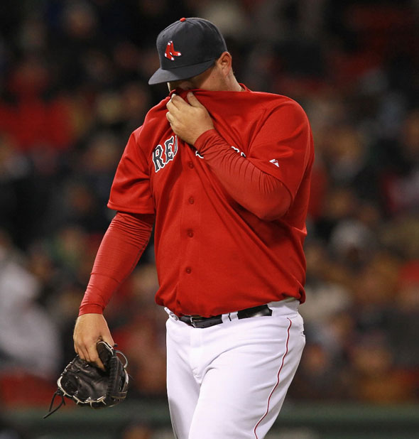 Things fell apart for Boston Red Sox relief pitcher Bobby Jenks (52) and the Sox relievers during the seventh inning.