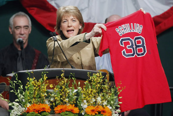 Massachusetts Attorney General Martha Coakley holds up a Red Sox jersey while speaking at the annual St. Patrick's Day breakfast in Boston, Sunday, March 14, 2010