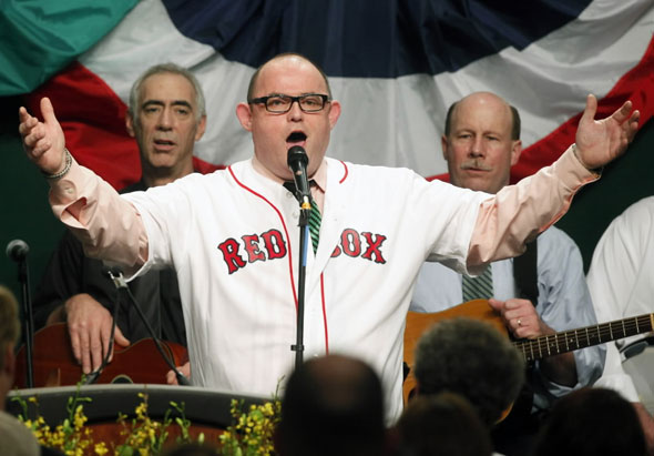 Tenor  Ronan  Tynan sings God Bless America in a Red Sox jersey during the annual St. Patrick's breakfast in Boston, Sunday, March 14, 2010.