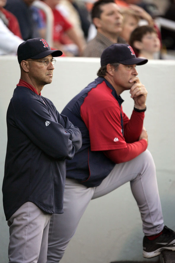 Red Sox manager Terry Francona, left, and pitching coach John Farrell, right, watch as Red Sox's Clay Buchholz pitches in the first inning of a spring training baseball game against the Minnesota Twins, in Fort Myers, Fla. Tuesday, March 23, 2010