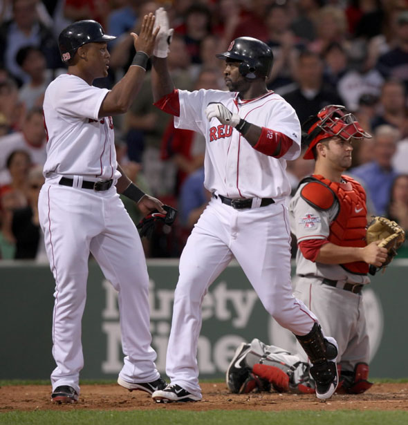 Red Sox vs. Los Angeles Angels - Adrian Beltre congratulates Bill Hall on his 2 run home run in 2nd inning.