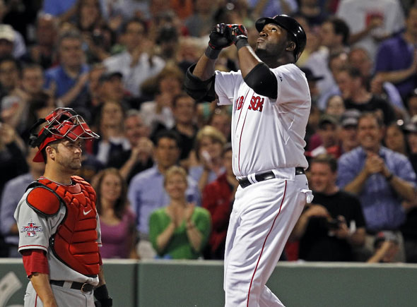 DH David Ortiz looks skyward as he crosses the plate on his fourth inning solo home run, Angels catcher Mike Napoli doesn't. The Boston Red Sox take on the Los Angeles Angels of Anaheim at Fenway Park.