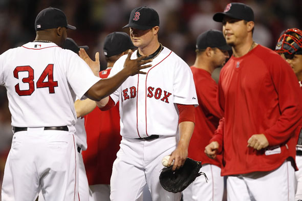 Jon Lester  is congratulated by David Ortiz #34 after pitching 9 innings in a 6-2 win. The Boston Red Sox play the Minnesota Twins in the 2nd game of their 2 game series at Fenway Park