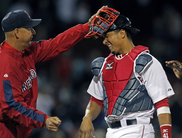 Red Sox manager Terry Francona gives catcher Victor Martinez (who is bracing fore a solid hit) a rap on the head as they celebrate the sweep of the Angels series. The Boston Red Sox take on the Los Angeles Angels of Anaheim at Fenway Park.