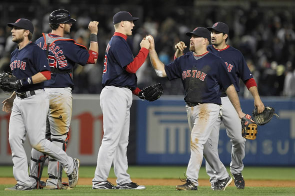 Jonathan Papelbon and Kevin Youkilis of the Boston Red Sox celebrate a 5-4 win against the New York Yankees on May 13, 2011 at Yankee Stadium in the Bronx borough of New York City.