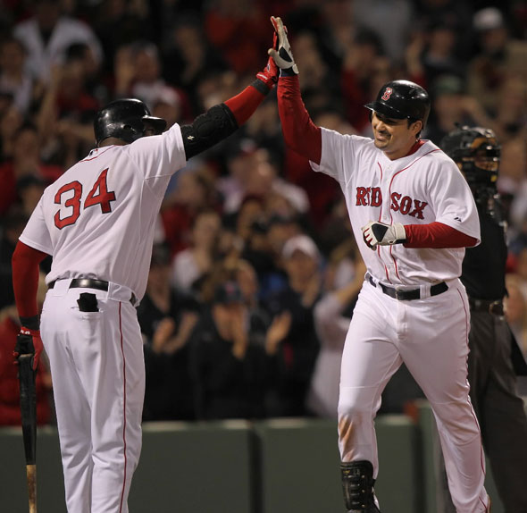 Adrian Gonzalez gets a high 5 from David Ortiz after his solo home run in the 8th inning.