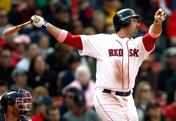 Boston Red Sox's Adrian Gonzalez watches his home run against the Minnesota Twins during the fifth inning of Boston's 9-5 win in a baseball game at Fenway Park in Boston Sunday, May 8, 2011.