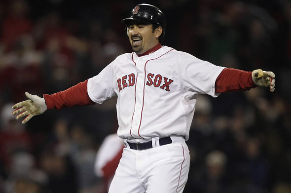 Adrian Gonzalez celebrates after his game-winning, two-run double against the Baltimore Orioles in the ninth inning of a baseball game at Fenway Park in Boston, Monday, May 16, 2011. The Red Sox won 8-7.