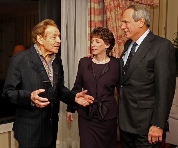 Jerry Stiller, left, talks to Laura Trust, and Larry Lucchino in Stiller's hotel room before the L'Dor VaDor Gala at the Four Seasons Boston on Thursday November 4, 2010. Lucchino found out Jerry Stiller is a Red Sox fan and offered him the chance to throw out the first pitch to a game