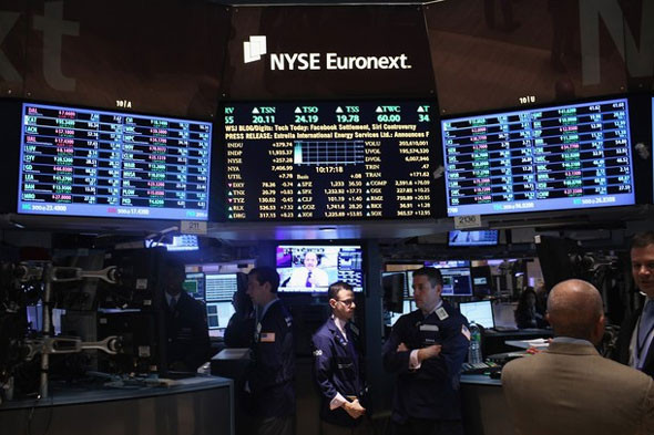 Traders work on the floor of the New York stock Exchange on November 30, 2011