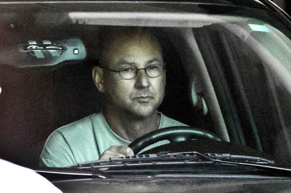 Terry Francona leaves Fenway Park in a black SUV after a meeting with Red Sox management including General Manager Theo Epstein.