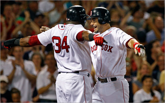 David Ortiz and Mike Lowell celebrate Lowell's homer