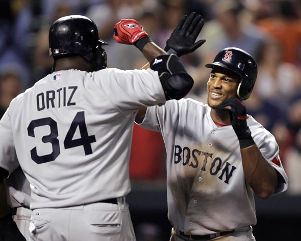 Adrian Beltre, right, celebrates his three-RBI home run with teammate David Ortiz (34) during the seventh inning of a baseball game against the Baltimore Orioles, Wednesday, Sept. 1, 2010