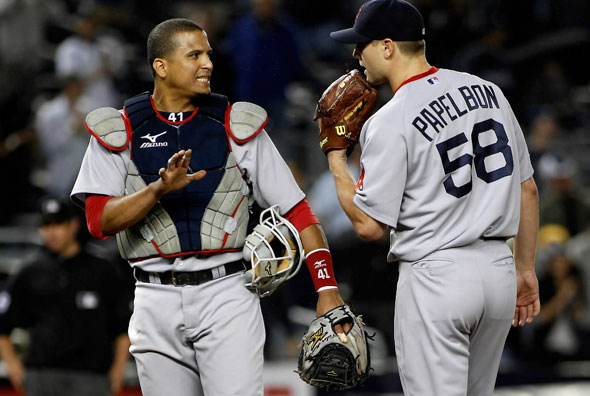 Catcher Victor Martinez of the Boston Red Sox talks to pitcher Jonathan Papelbon during the ninth-inning aganinst the New York Yankees bunt attempt in the 10th inning on September 26, 2010 at Yankee Stadium in the Bronx borough of New York City. The Yankees won 4-3.