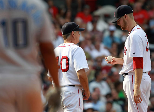 Boston Red Sox pitching coach talks with Boston Red Sox relief pitcher Bard after Bard exhibited an inability to throw a strike walking Toronto Blue Jays designated hitter Encarnacion in the eighth.