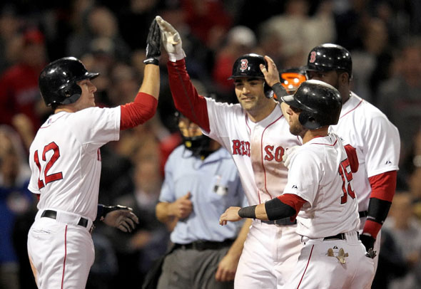 Conor Jackson Red Sox celebrates his grand slam with Jed Lowrie of the Boston Red Sox, Dustin Pedroia of the Boston Red Sox, and David Ortiz of the Boston Red Sox during the second game of a doubleheader with the Baltimore Orioles at Fenway Park September 19, 2011 in Boston, Massachusetts.