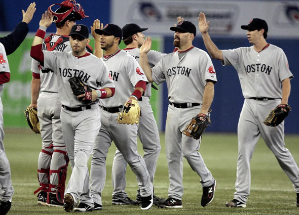 SEPTEMBER 6: Boston Red Sox celebrate the win against the Toronto Blue Jays during MLB action at the Rogers Centre September 6, 2011 in Toronto, Ontario, Canada