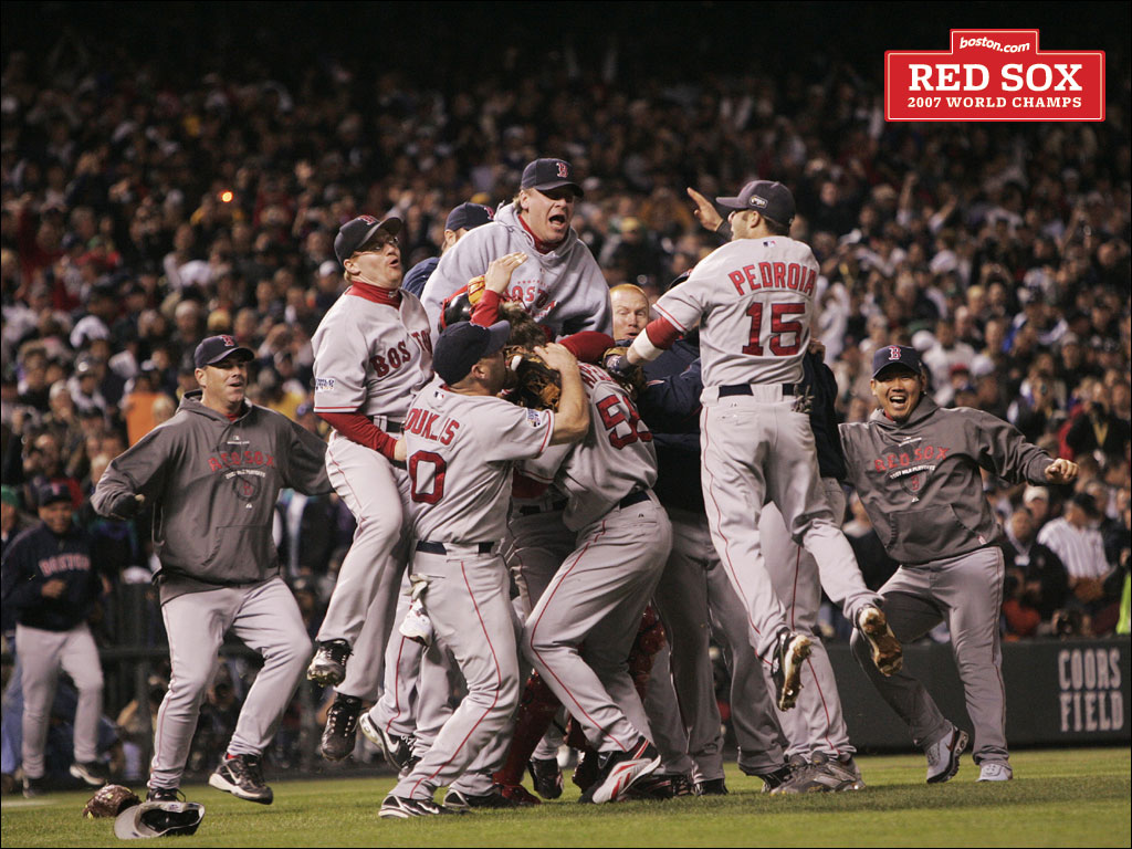 The Boston Red Sox pour onto the field at Coors Field to celebrate their