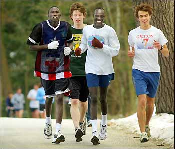 Gabriel Bol Akau runs with friends.