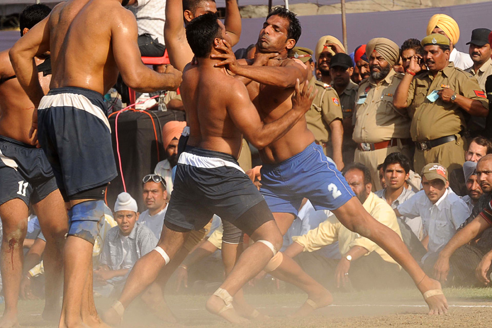 opponent during the 1st Pearls World Cup Kabaddi Punjab-2010 tournament