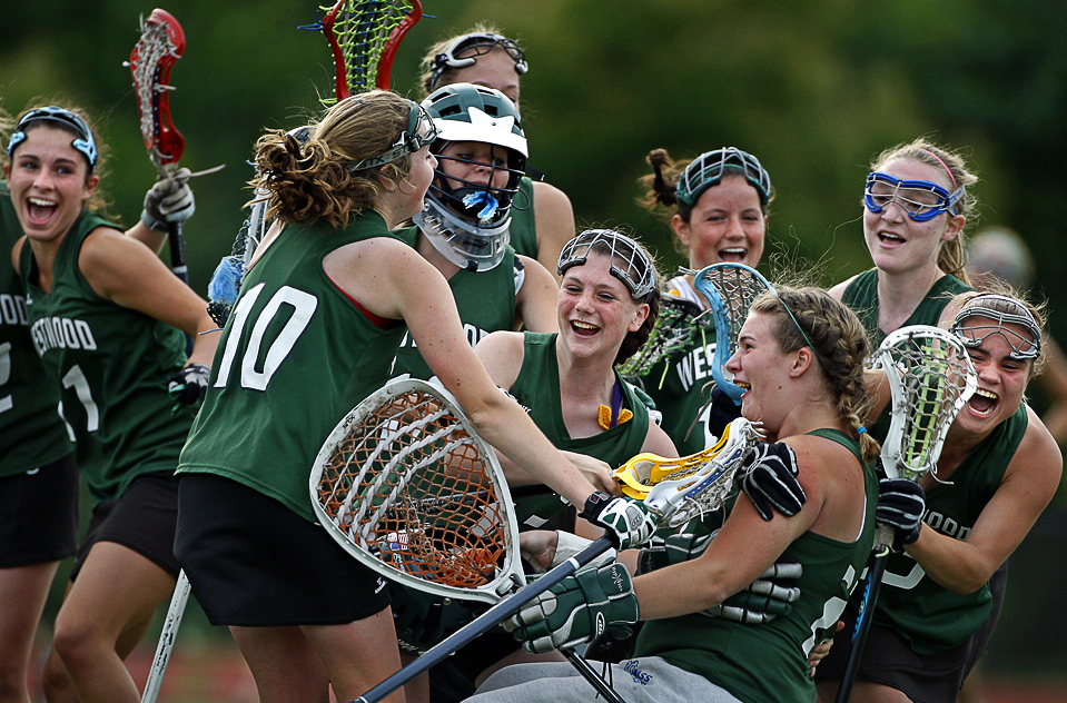 Westwood, Mass. high school lacrosse players rejoice after winning the South Sectional Final versus Wellesley High at Wellesley College June 4. (Jim Davis/Globe Staff) 