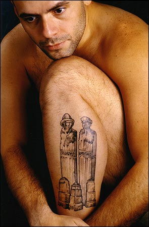 Police detective Francis Coppola's tattoo depicts two towering figures