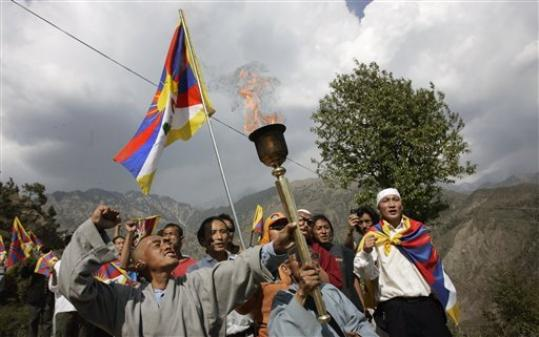 Tibetan Youth Congress activists shout slogans as they carry the Tibet Independence Torch in Dharmsala, India, Tuesday, March 25, 2008. Nearly 50 Tibetan exiles began the torch relay Tuesday that will take the symbolic Olympic flame from northern India through cities on five continents before ending in Tibet the day of the games' opening ceremonies in Beijing, organizers said.