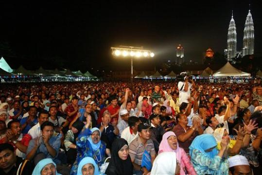 Supporters of former Malaysian Deputy Prime Minister Anwar Ibrahim listen during a rally to celebrate the political rebirth of Anwar in Kuala Lumpur, Malaysia, Monday, April 14, 2008.