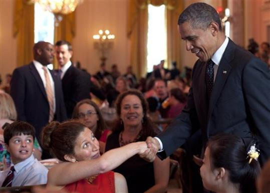 President Barack Obama shakes hands during the Kids' 'State Dinner,' hosted by first lady Michelle Obama, Monday, Aug. 20, 2012, in the East Room of the White House in Washington