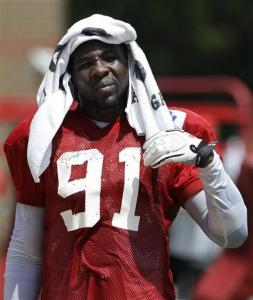 FILE - This Aug. 6, 2011 file photo shows Kansas City Chiefs linebacker Tamba Hali trying to stay cool during NFL football training camp in St Joseph, Mo. The NFL has suspended All-Pro linebacker Hali for the season-opener against Atlanta for violating its policy on substance abuse. The league announced the suspension Monday, Aug. 20, 2012, without disclosing details.