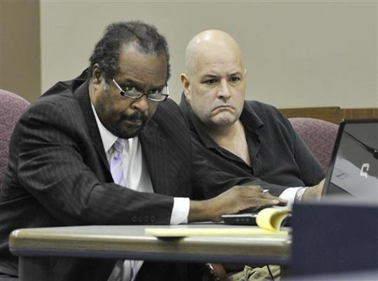 Defense attorney Mark Brown and suspect Roger Bowling, right, listen during a preliminary examination at the 24th District Court in Allen Park, Mich. on Monday, Aug. 20, 2012. Bowling is a suspect in the murders of Chris Hall and Danielle Greenway, whose dismembered remains were found in the Detroit River.