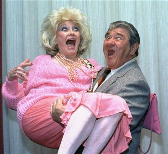 FILE-In this Oct. 9, 1985, file photo, Comedian Phyllis Diller gets a lift from emcee Buddy Hackett prior to the celebrity stag luncheon roast at the New York Friars Club in New York City. Diller, the housewife turned humorist who aimed some of her sharpest barbs at herself, died Monday, Aug. 20, 2012, at age 95 in Los Angeles.