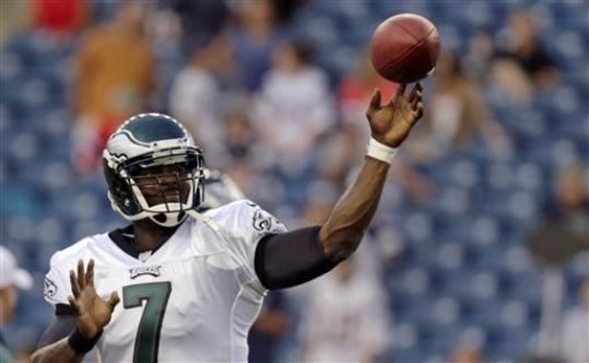 Philadelphia Eagles quarterback Michael Vick (7) throws during warm ups prior to facing the New England Patriots in an NFL preseason football game in Foxborough, Mass., Monday, Aug. 20, 2012.