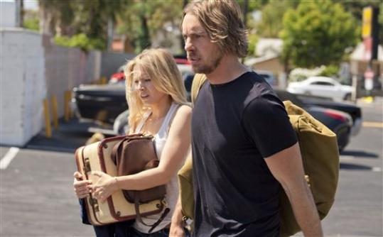 This film image released by Open Road Films shows, Kristen Bell, left, and Dax Shepard in a scene from 'Hit and Run.'