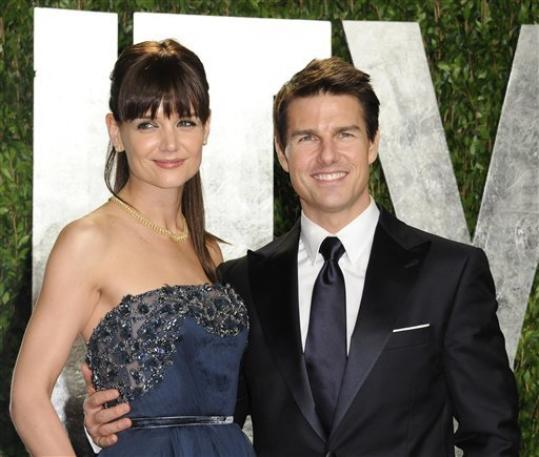FILE - In this Feb. 26, 2012 file photo, actors Tom Cruise and Katie Holmes arrive at the Vanity Fair Oscar party, in West Hollywood, Calif. Court records filed in a New York City court indicate the case was closed Monday, Aug. 20. Holmes and Cruise said in July they had reached an agreement less than two weeks into their headline-dominating divorce case. Their lawyers and representatives wouldn't disclose details. The couple were married in Italy in 2006. They have a 6-year-old daughter, Suri.