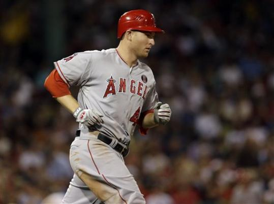 Los Angeles Angels' Mark Trumbo runs to first after hitting a two-run home run against the Boston Red Sox during the fifth inning of a baseball game at Fenway Park in Boston on Tuesday, Aug. 21, 2012.