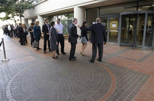 People wait in line to get inside for the Apple and Samsung trial during a lunch break at a federal courthouse in San Jose, Calif., Tuesday, Aug. 21, 2012. After three weeks of listening to technology experts, patent professionals and company executives debate the complicated legal claims of Apple Corp. and Samsung Electronics Co., a jury of nine men and women are set to decide one of the biggest technology disputes in history.