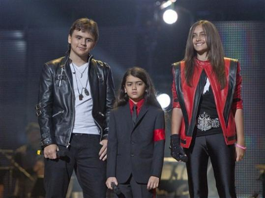 FILE - In this Oct. 8, 2011 file photo, from left, Prince Jackson, Prince Michael II 'Blanket'Jackson and Paris Jackson arrive on stage at the Michael Forever the Tribute Concert, at the Millennium Stadium in Cardiff, Wales. A judge is expected on Wednesday Aug. 22, 2012 to appoint Michael Jackson's nephew TJ Jackson to serve as co-guardian of the singer's three children, sharing duties with family matriarch Katherine Jackson.