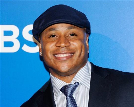 FILE - This May 16, 2012 file photo shows 'NCIS: Los Angeles' cast member LL COOL J at the CBS network upfront presentation at The Tent at Lincoln Center in New York. Los Angeles police say the rapper grabbed and held a burglary suspect at his Studio City home Wednesday morning. Police got a 911 call shortly before 1 a.m. from someone who said her father had spotted an intruder in their home and was holding him downstairs. Officers arrived and took a man into custody. Police say he had minor bruises and will be arrested on suspicion of burglary. His name hasn't been released. LL Cool J wasn't hurt and apparently nothing was taken.