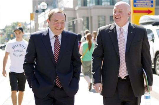 NHL commissioner Gary Bettman, left, and deputy commisioner and chief legal officer Bill Daly, Deputy Commissioner leave the NHLPA offices in Toronto on Wednesday, Aug. 22, 2012. Negotiations continue between the NHL and the NHLPA over collective bargaining as both sides try to avoid a potential lockout.