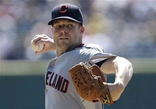 Cleveland Indians starting pitcher Corey Kluber throws against the Detroit Tigers in the first inning of a baseball game in Detroit, Monday, Sept. 3, 2012.
