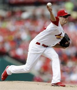 St. Louis Cardinals starting pitcher Joe Kelly throws during the first inning of a baseball game against the New York Mets, Monday, Sept. 3, 2012, in St. Louis.