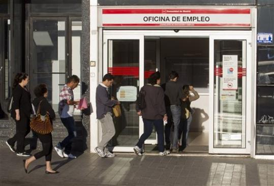 People queue outside an unemployment registry office in Madrid, Tuesday Sept. 4, 2012. Spain says the number of people registered unemployed and claiming benefits rose in August by 38,179 people compared to the previous month, the first increase in five months in a deepening recession. At the end of the second quarter Spain reached the European Union's highest unemployment rate at 24.6 percent, a new overall rate won't be released until October.