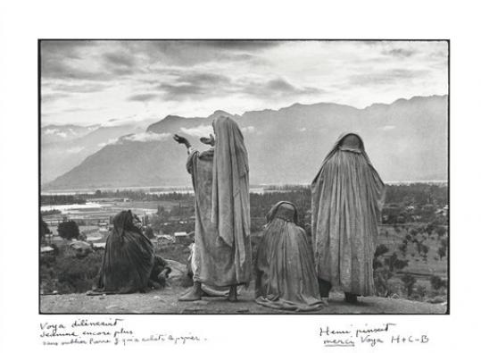In this image released by Christie's auction house, Tuesday, Sept. 4, 2012, is a signed photograph by Henri Cartier-Bresson taken in 1948 in Srinagar, India. One man alone was responsible for printing the vast majority of his black-and-white photos between 1967and 1997. In gratitude, Cartier-Bresson presented Voja Mitrovic with nearly 30 signed and inscribed photographs, some rarely seen by the public. They are to be auctioned in October in New York.