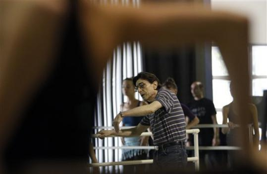In this photo taken Tuesday, July 31, 2012, Edward Villella, founding artistic director of the Miami City Ballet, watches dancers during a company class in Miami Beach, Fla. Villella, who built the Miami City Ballet into an internationally recognized company, has left sooner than expected, the company announced Tuesday, Sept. 4, 2012. Villella, 75, said last year he would retire after the 2012-2013 season ends in April. But ballet officials announced Tuesday that Villella has decided to leave now.