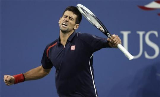 Novak Djokovic, of Serbia, reacts after winning a point against Juan Martin del Potro, of Argentina, during a quarterfinal of the U.S. Open tennis tournament, Thursday, Sept. 6, 2012, in New York.