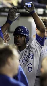 Kansas City Royals' Lorenzo Cain gets high fives in the dugout after hitting a home run against the Chicago White Sox during the fifth inning of a baseball game, Friday, Sept. 7, 2012, in Chicago.